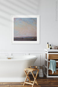 "Square abstract landscape painting ""Flaming June,"" canvas wall art by Victoria Primicias, decorates the bathroom."