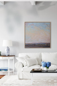 "Square abstract landscape painting ""Flaming June,"" canvas wall art by Victoria Primicias, decorates the living room."