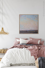 "Load image into Gallery viewer, Square abstract beach painting ""Flaming June,"" canvas print by Victoria Primicias, decorates the bedroom."