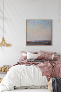"Square abstract beach painting ""Flaming June,"" canvas print by Victoria Primicias, decorates the bedroom."