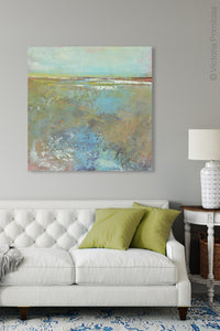 "Colorful abstract landscape painting ""Floating Gallery,"" fine art print by Victoria Primicias, decorates the living room."