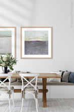 "Load image into Gallery viewer, Purple gray abstract beach artwork ""Fog Island,"" giclee print by Victoria Primicias, decorates the dining room."