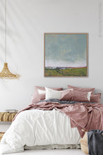 "Load image into Gallery viewer, Serene abstract coastal wall decor ""Golden Lining,"" digital print by Victoria Primicias, decorates the bedroom."