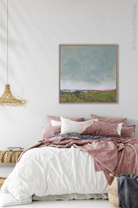 "Serene abstract coastal wall decor ""Golden Lining,"" digital print by Victoria Primicias, decorates the bedroom."
