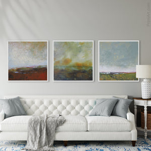 "Serene abstract coastal wall decor ""Golden Lining,"" digital print by Victoria Primicias, decorates the living room."