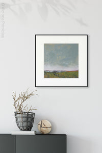 "Serene abstract coastal wall decor ""Golden Lining,"" digital print by Victoria Primicias, decorates the foyer."