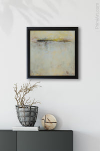 "Square yellow modern seascape painting ""Guardian Promise"" decorates a small wall above a console table in the entryway."