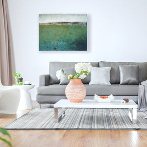 "Green abstract original art ""Healing Tides,"" landscape painting by Victoria Primicias, decorates the living room."