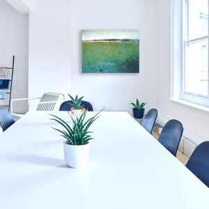 "Green abstract original art ""Healing Tides,"" landscape painting by Victoria Primicias, decorates an office wall."