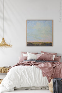 "Blue abstract beach artwork ""Hello Again,"" downloadable art by Victoria Primicias, decorates the bedroom."