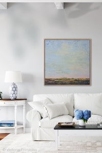 "Blue abstract beach artwork ""Hello Again,"" digital print by Victoria Primicias, decorates the living room."