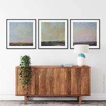 "Load image into Gallery viewer, Blue abstract beach artwork ""Hello Again,"" downloadable art by Victoria Primicias, decorates the entryway."