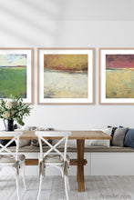 "Load image into Gallery viewer, Red and gold abstract beach artwork ""Imperial Secrets,"" metal print by Victoria Primicias, decorates the dining room."