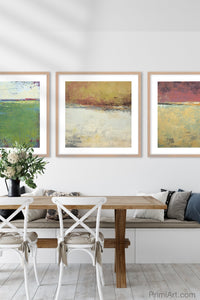 "Red and gold abstract beach artwork ""Imperial Secrets,"" metal print by Victoria Primicias, decorates the dining room."