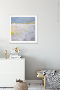 "Yellow and gray abstract ocean wall art ""Inner Ocean,"" wall art print by Victoria Primicias, decorates the entryway."