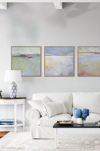 "Yellow and gray abstract beach artwork ""Inner Ocean,"" fine art print by Victoria Primicias, decorates the living room."