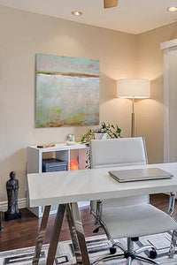 "Neutral color abstract landscape art ""Ivory Shore,"" digital print by Victoria Primicias, decorates the office."