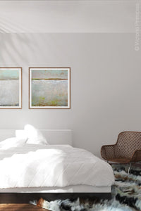 "Neutral color abstract landscape art ""Ivory Shore,"" digital print by Victoria Primicias, decorates the bedroom."