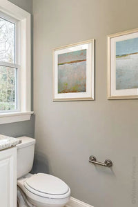 "Gray abstract ocean art ""Ivory Shore,"" canvas wall art by Victoria Primicias, decorates the bathroom."