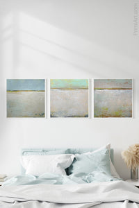 "Gray abstract ocean art ""Ivory Shore,"" canvas wall art by Victoria Primicias, decorates the bedroom."