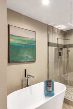 "Load image into Gallery viewer, Verdant green abstract coastal wall art ""Jade Lea,"" digital print by Victoria Primicias, decorates the bathroom."
