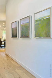 "Green landscape painting ""Kelly Corridor,"" canvas wall art by Victoria Primicias, decorates the entryway."