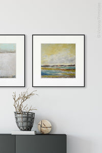 "Coastal abstract landscape painting ""Lapping Layers,"" digital download by Victoria Primicias, decorates the foyer."