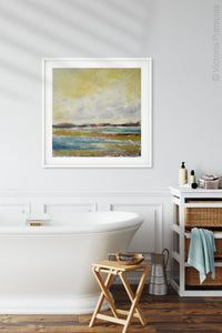 "Yellow coastal abstract landscape art ""Lapping Layers,"" canvas print by Victoria Primicias, decorates the dining room."
