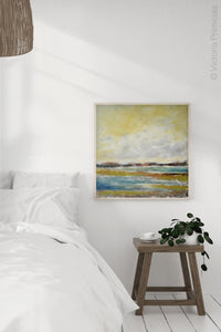 "Yellow coastal abstract landscape painting ""Lapping Layers,"" giclee print by Victoria Primicias, decorates the bedroom."