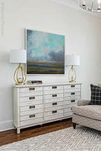 "Load image into Gallery viewer, Square abstract landscape art ""Last Soiree,"" printable wall art by Victoria Primicias, decorates the living room."