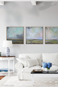 "Teal abstract landscape painting ""Last Soiree,"" canvas print by Victoria Primicias, decorates the living room."