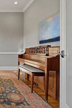 Load image into Gallery viewer, Blue seascape with low horizon and vast skies sits above a piano in the living room.