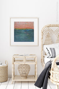 "Modern abstract coastal wall art ""Lost Emerald,"" digital print by Victoria Primicias, decorates the bedroom."