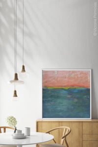 "Modern abstract coastal wall decor ""Lost Emerald,"" digital print by Victoria Primicias, decorates the dining room."