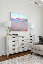 "Load image into Gallery viewer, Sweet square abstract seascape painting ""Marathon Miles,"" printable wall art by Victoria Primicias, decorates the living room."