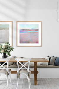 "Pink abstract beach art ""Marathon Miles,"" canvas print by Victoria Primicias, decorates the dining room."
