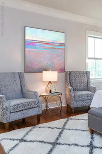 "Pink abstract beach painting ""Marathon Miles,"" canvas wall art by Victoria Primicias, decorates the bedroom."