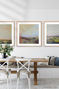 "Modern abstract beach artwork ""Martini Morning,"" printable wall art by Victoria Primicias, decorates the dining room."