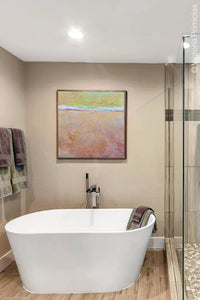 "Pink abstract ocean painting ""Melon Melee,"" metal print by Victoria Primicias, decorates the bathroom."