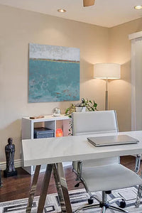 "Bluegreen abstract beach paintings ""Merchant Crossing,"" canvas wall art by Victoria Primicias, decorates the office."