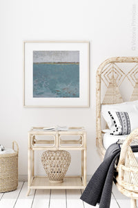 "Bluegreen abstract beach paintings ""Merchant Crossing,"" canvas wall art by Victoria Primicias, decorates the bedroom."