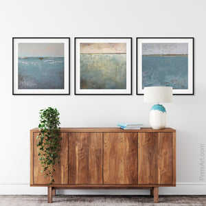 "Bluegreen abstract ocean paintings ""Merchant Crossing,"" canvas print by Victoria Primicias, decorates the entryway."