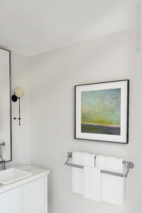 "Square abstract beach artwork ""Merchant Skies,"" fine art print by Victoria Primicias, decorates the bathroom."