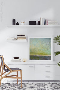 "Square abstract ocean wall art ""Merchant Skies,"" wall art print by Victoria Primicias, decorates the office."