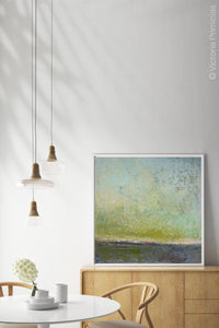 "Square abstract landscape painting ""Merchant Skies,"" giclee print by Victoria Primicias, decorates the dining room."