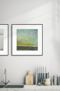 "Square abstract landscape painting ""Merchant Skies,"" giclee print by Victoria Primicias, decorates the kitchen."