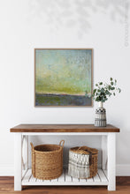"Load image into Gallery viewer, Square abstract ocean wall art ""Merchant Skies,"" wall art print by Victoria Primicias, decorates the foyer."