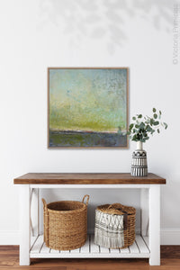 "Square abstract ocean wall art ""Merchant Skies,"" wall art print by Victoria Primicias, decorates the foyer."
