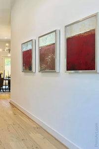 "Red abstract beach artwork ""Merlot Passage,"" canvas art print by Victoria Primicias, decorates the foyer."