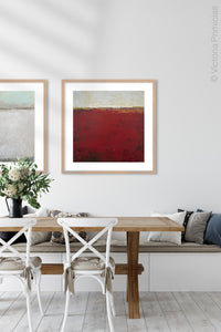 "Red abstract ocean wall art ""Merlot Passage,"" canvas print by Victoria Primicias, decorates the dining room."